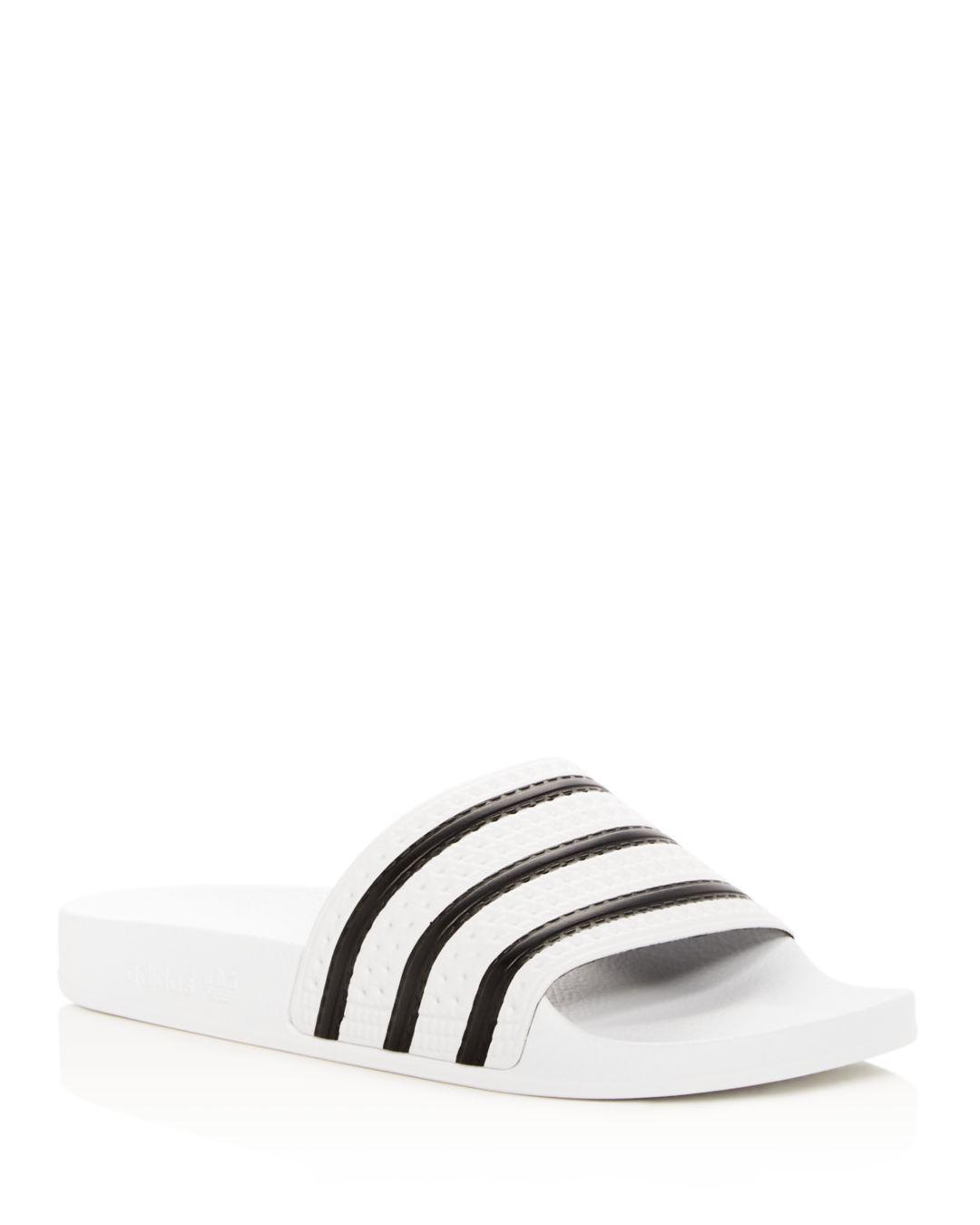 buy online a7f23 8306a Adidas - Blue Adilette Slide Sandals for Men - Lyst. View fullscreen
