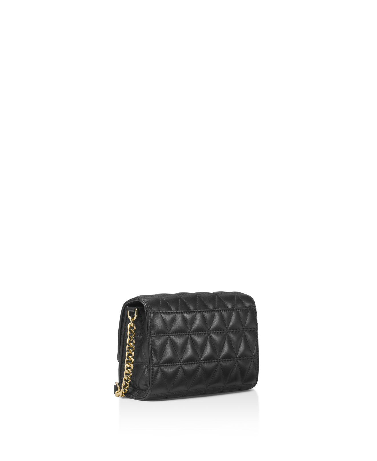 2ab245b965 Gallery. Previously sold at  Bloomingdale s · Women s Michael Kors Quilted  ...