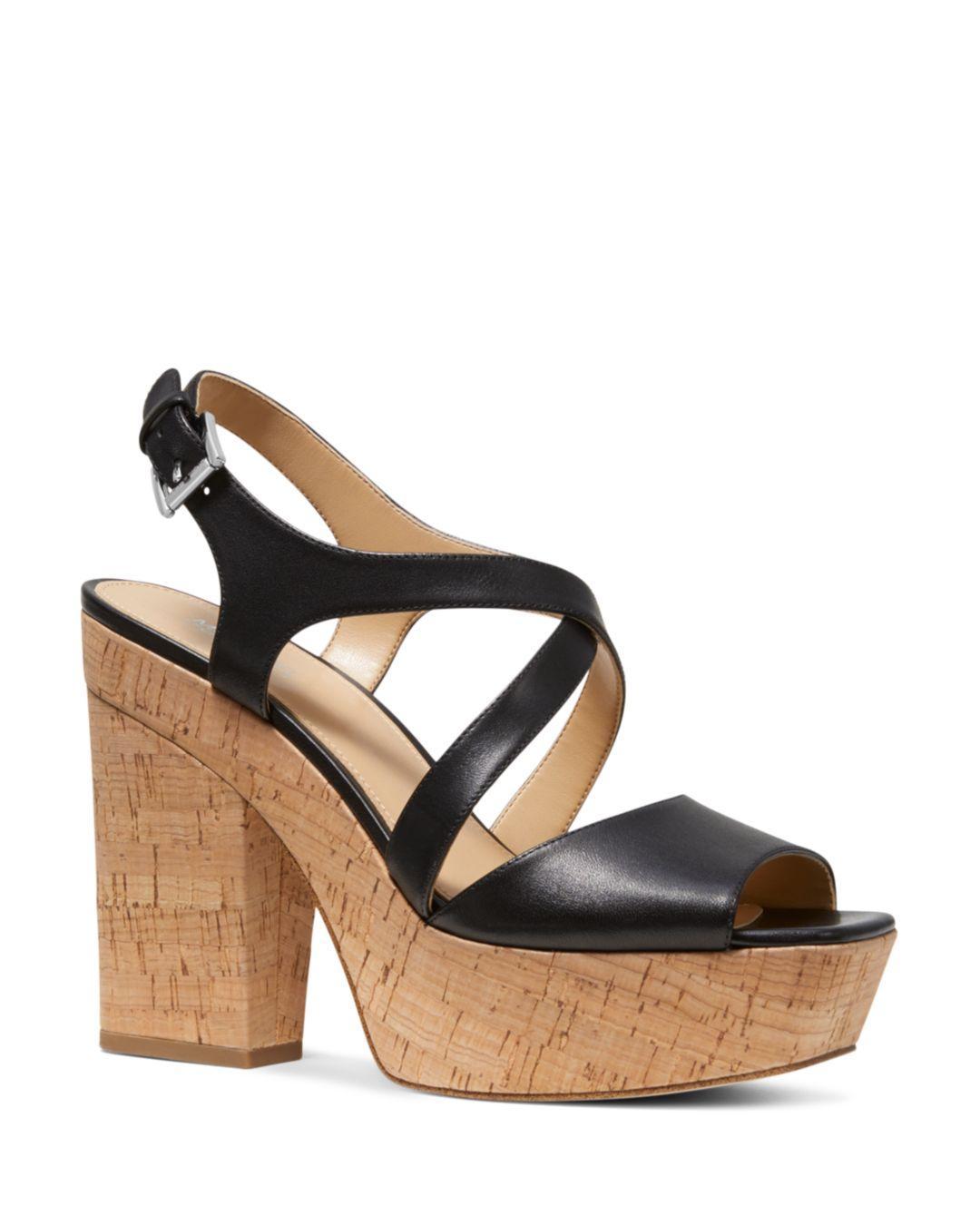 7eafb63dcd6 MICHAEL Michael Kors. Black Women s Abbott Leather Platform Wedge Sandals