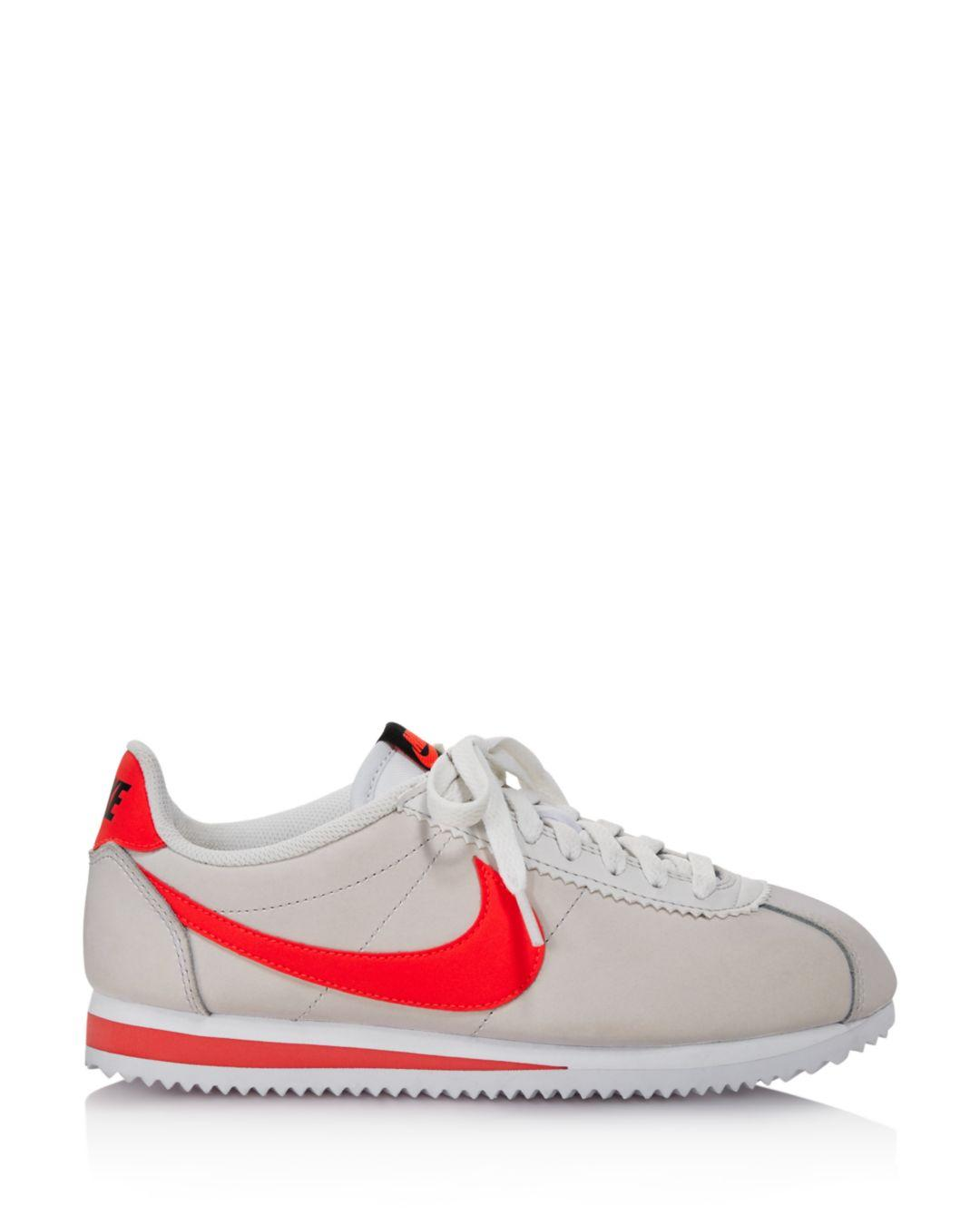 ab2bea6679d3 Lyst - Nike Women s Classic Cortez Leather Lace Up Sneakers in White - Save  26%