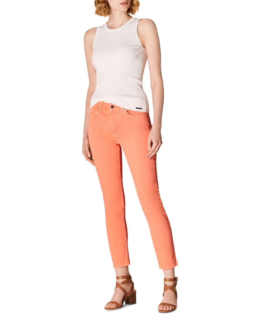 8d88680532 ... Orange Cropped Skinny Jeans In Coral - Lyst. View fullscreen