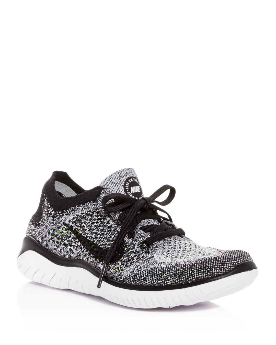 770829a90771 Lyst - Nike Women s Free Rn Flyknit 2018 Lace Up Sneakers in Black ...