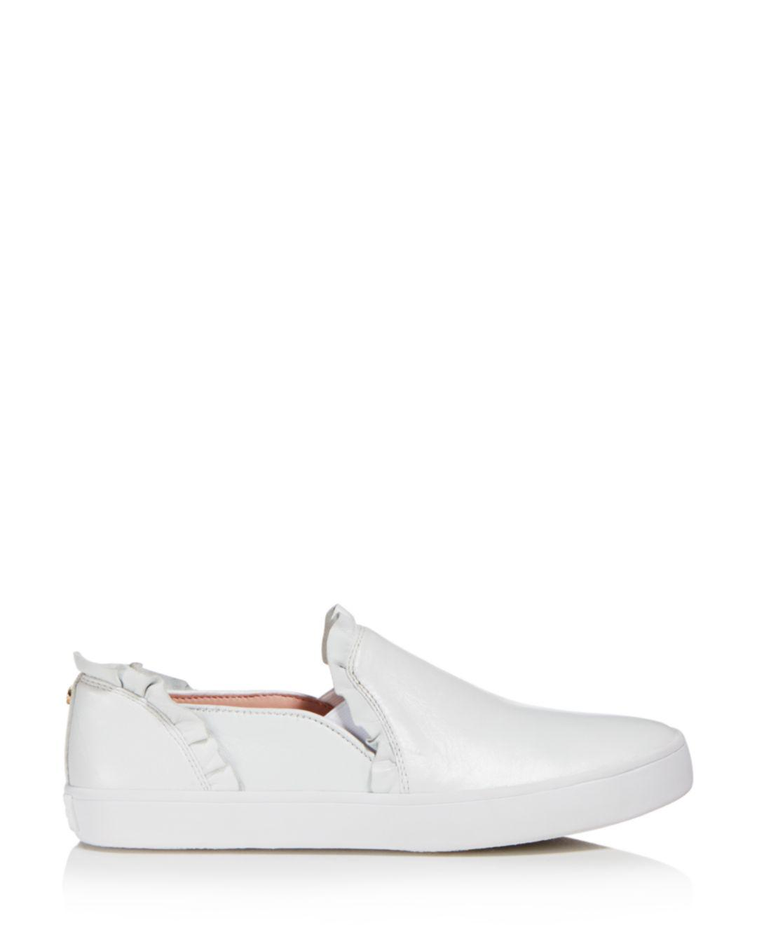 Kate Spade Women s Lilly Ruffle-trim Leather Slip-on Sneakers in White -  Lyst c6e59649da
