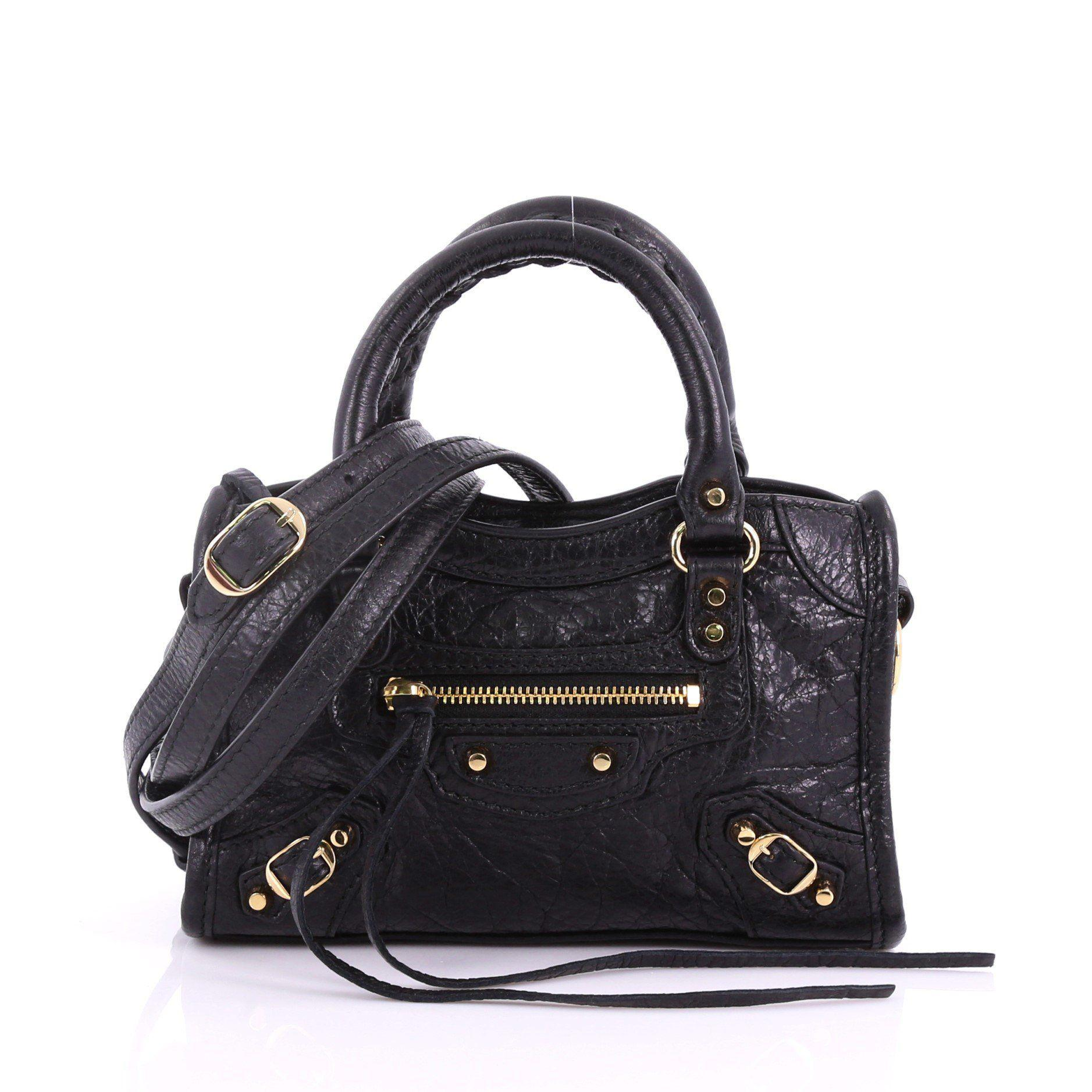 Lyst - Balenciaga Pre Owned City Classic Studs Handbag Leather Nano ... 2195f426315ba