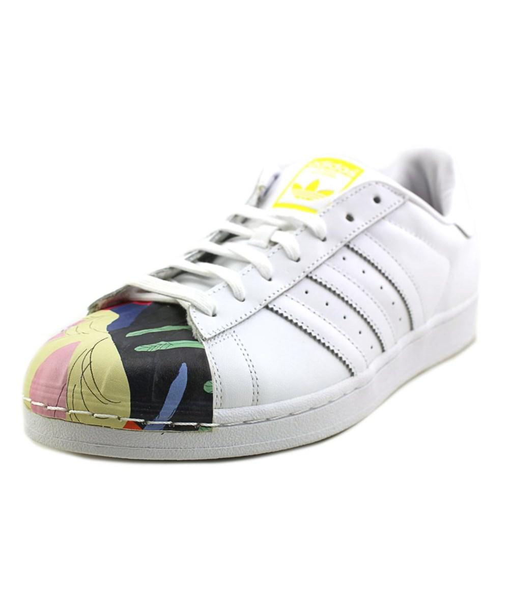 buy popular 77532 c3965 ... buy lyst adidas superstar pharrell supersh men round toe leather white  0de10 57647