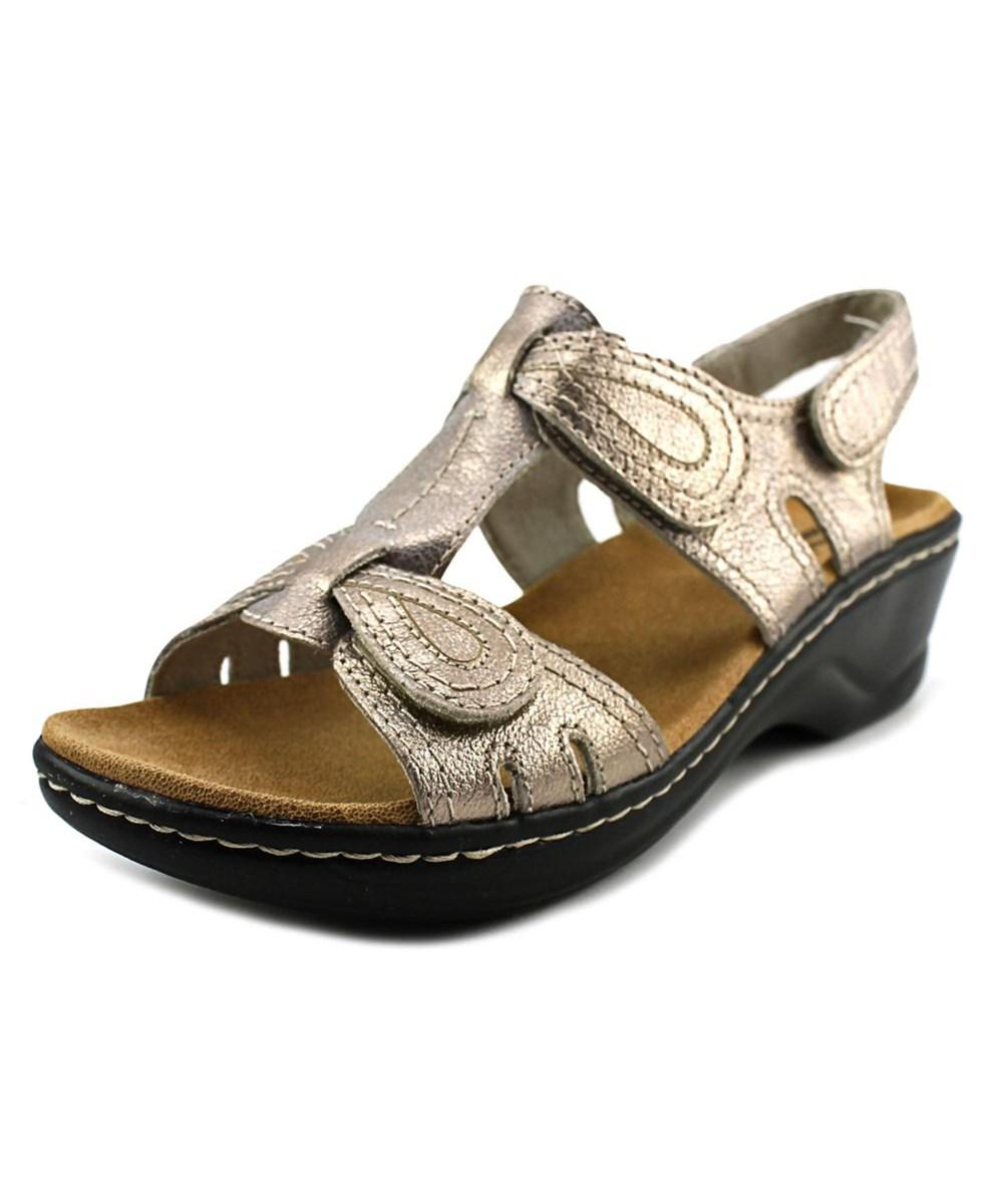 fb9e6363d6b4 Lyst - Clarks Lexi Walnut Q Women W Open Toe Leather Gold Wedge ...