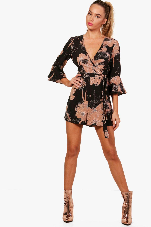 9b3127514326 Boohoo - Black Floral Wrap   Ruffle Sleeve Playsuit - Lyst. View fullscreen