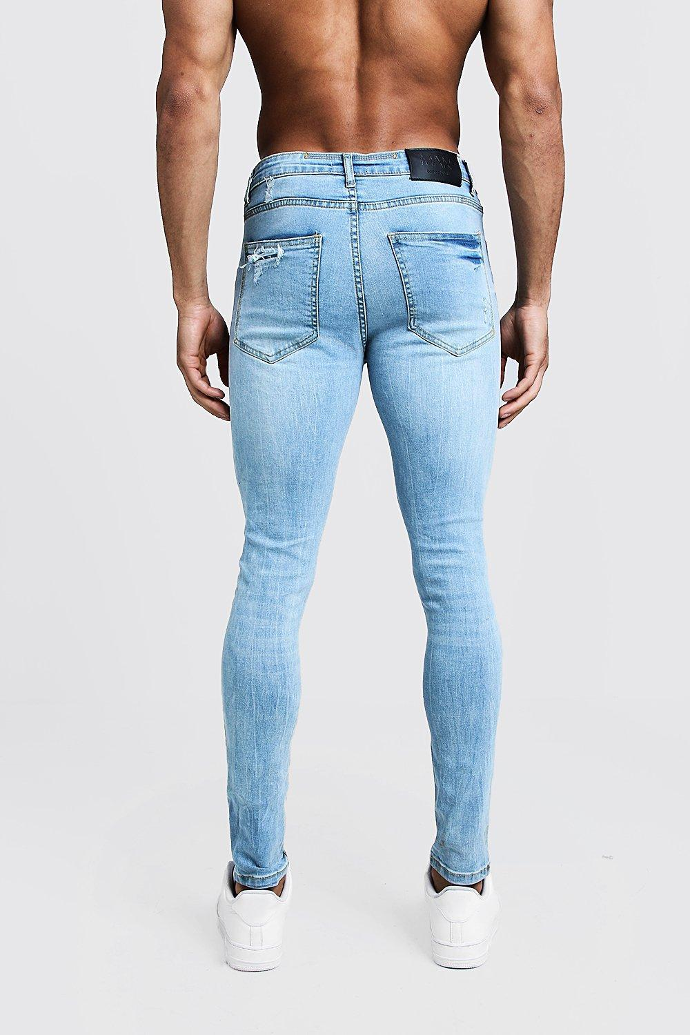 256b0618cec47 BoohooMAN - Blue Spray On Skinny Jeans With Distressed Knees for Men - Lyst.  View fullscreen