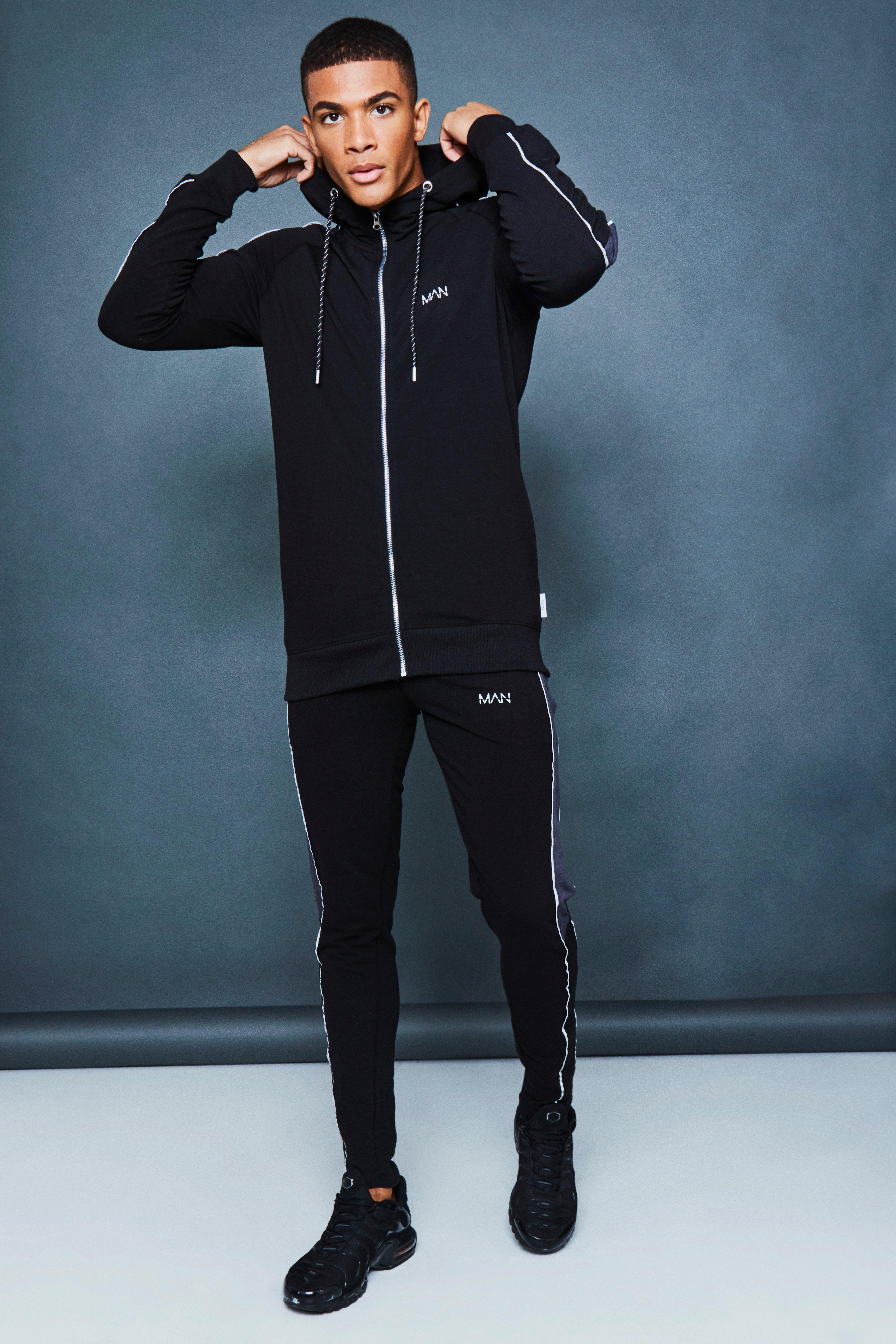 97a9da266b51 BoohooMAN. Men's Black Muscle Fit Panelled Reflective Detail Tracksuit