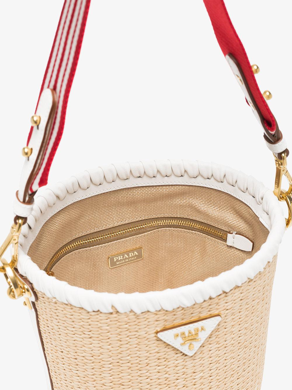 a02d06ab30b5 ... reduced prada white nude and red logo raffia bucket bag in natural lyst  bbcf9 47cbf
