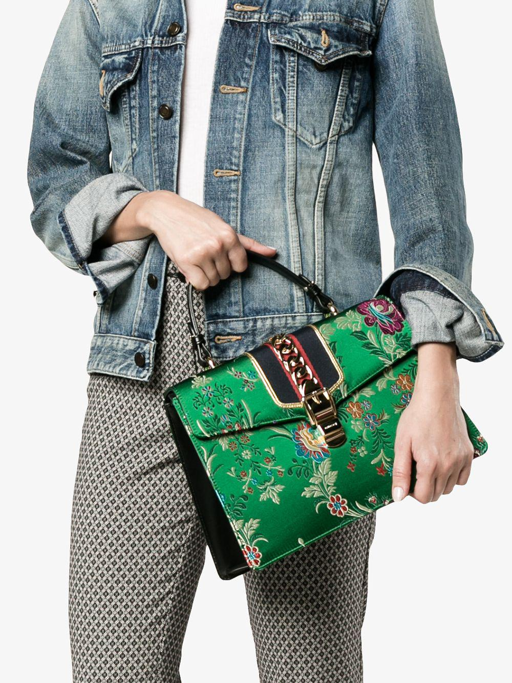 e2dfb51cd35b Lyst - Gucci Medium Sylvie Floral Print Bag With Top Handle in Green - Save  7%