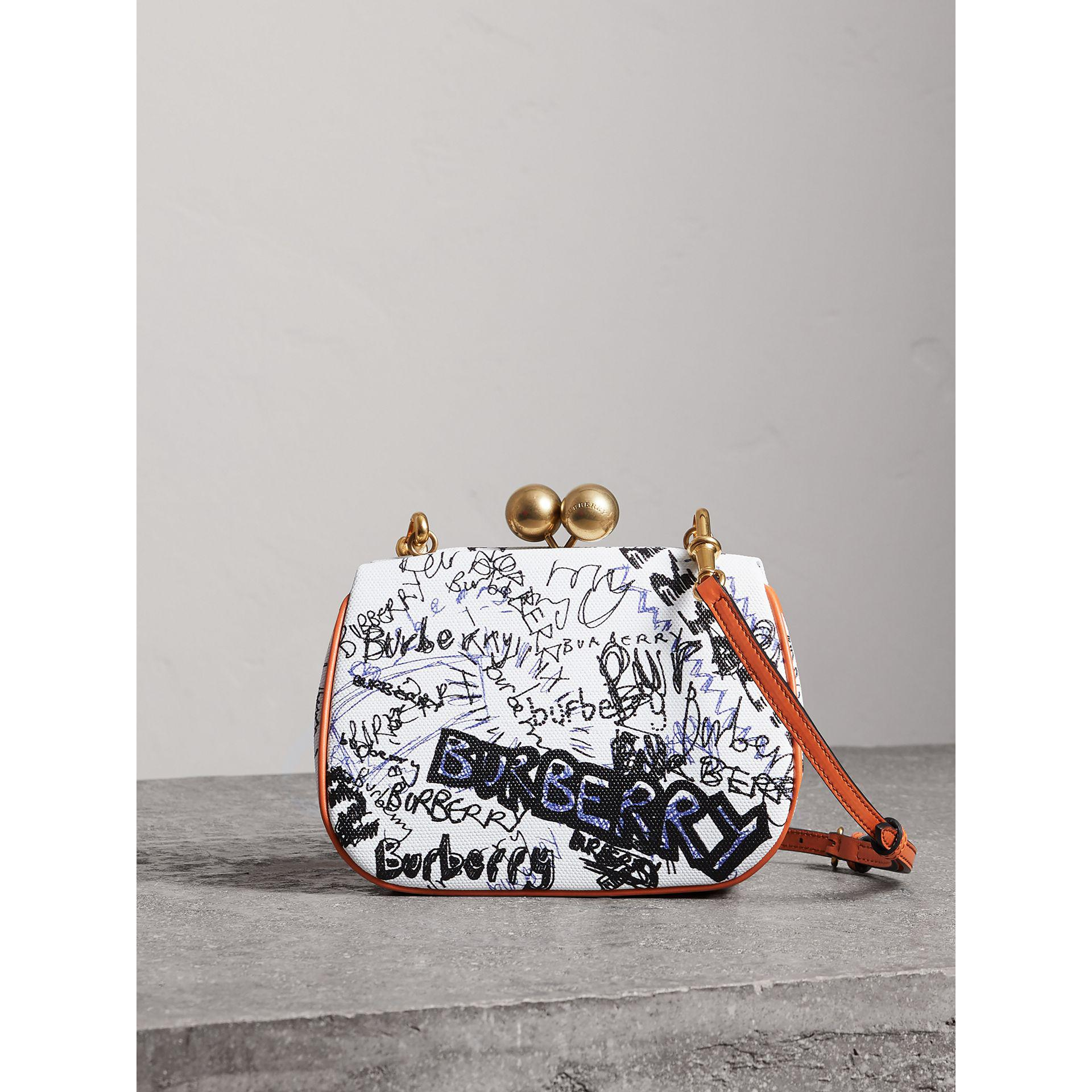 Lyst - Burberry Small Doodle Print Metal Frame Clutch Bag in White 46fbddb60bccc