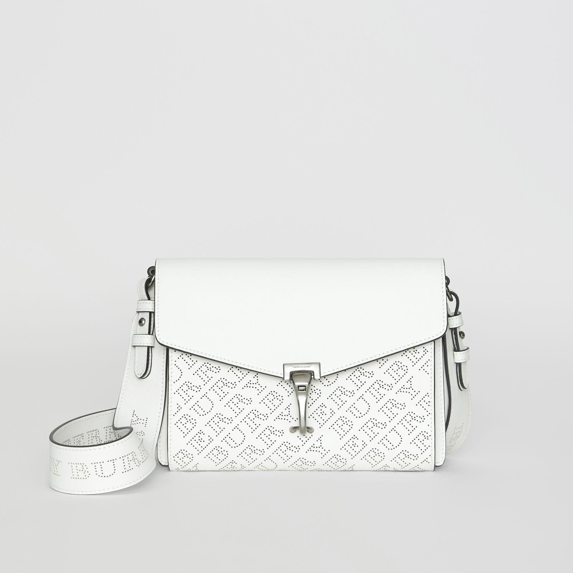 7c39bb39b1fb Lyst - Burberry Small Perforated Logo Leather Crossbody Bag in White
