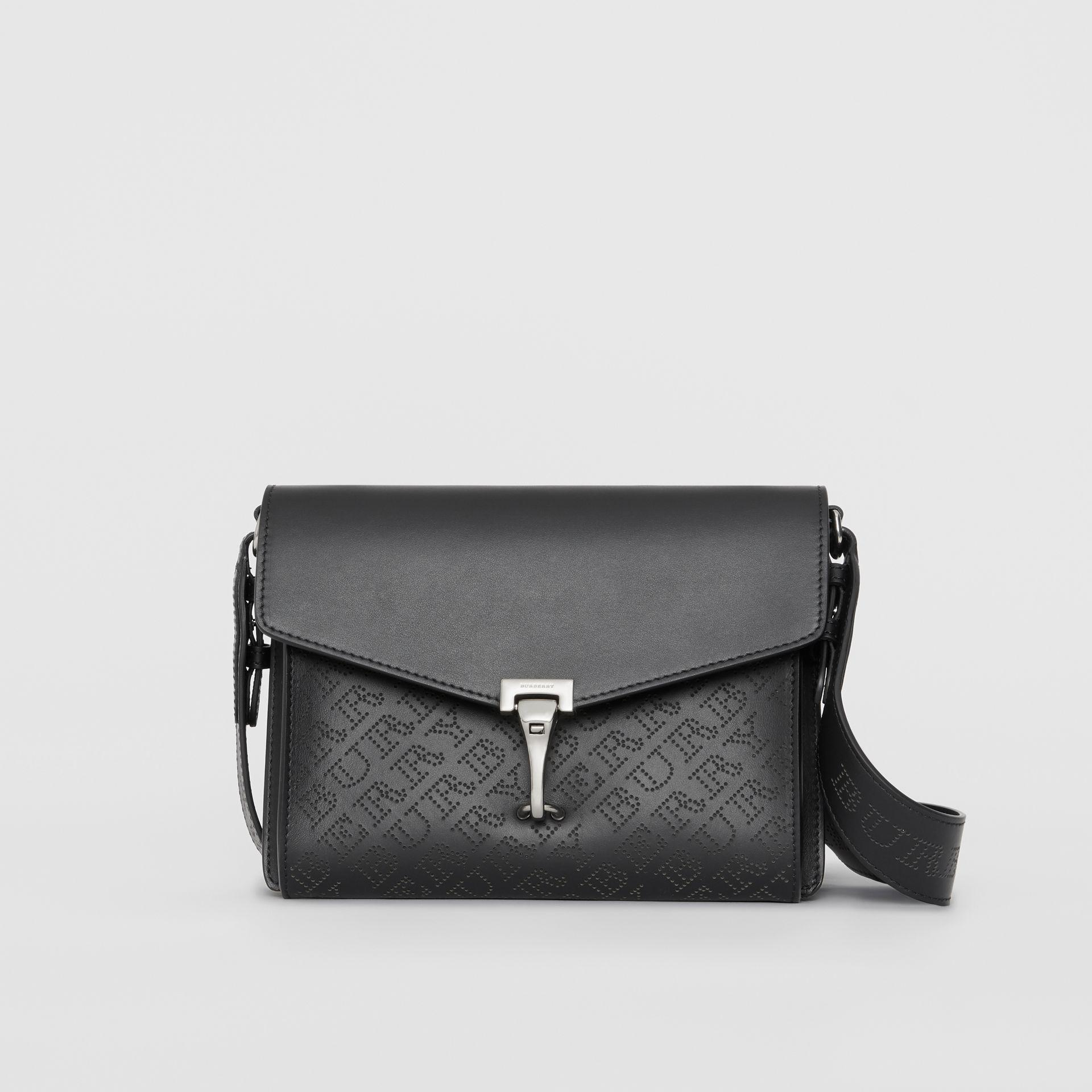 e5a83fd394ae Lyst - Burberry Small Perforated Logo Leather Crossbody Bag in Black