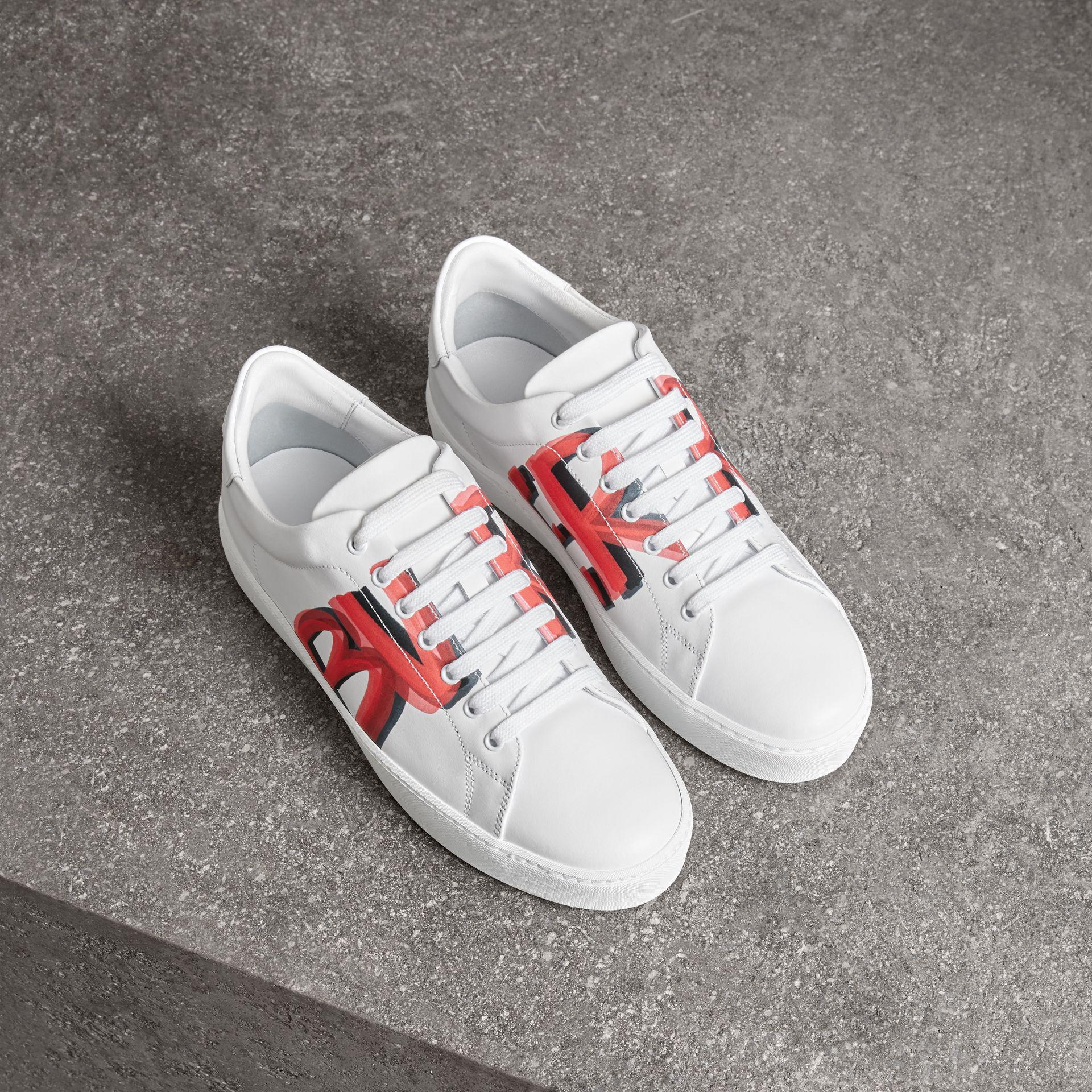 ce639564a5cc Burberry Graffiti Print Leather Sneakers - Lyst