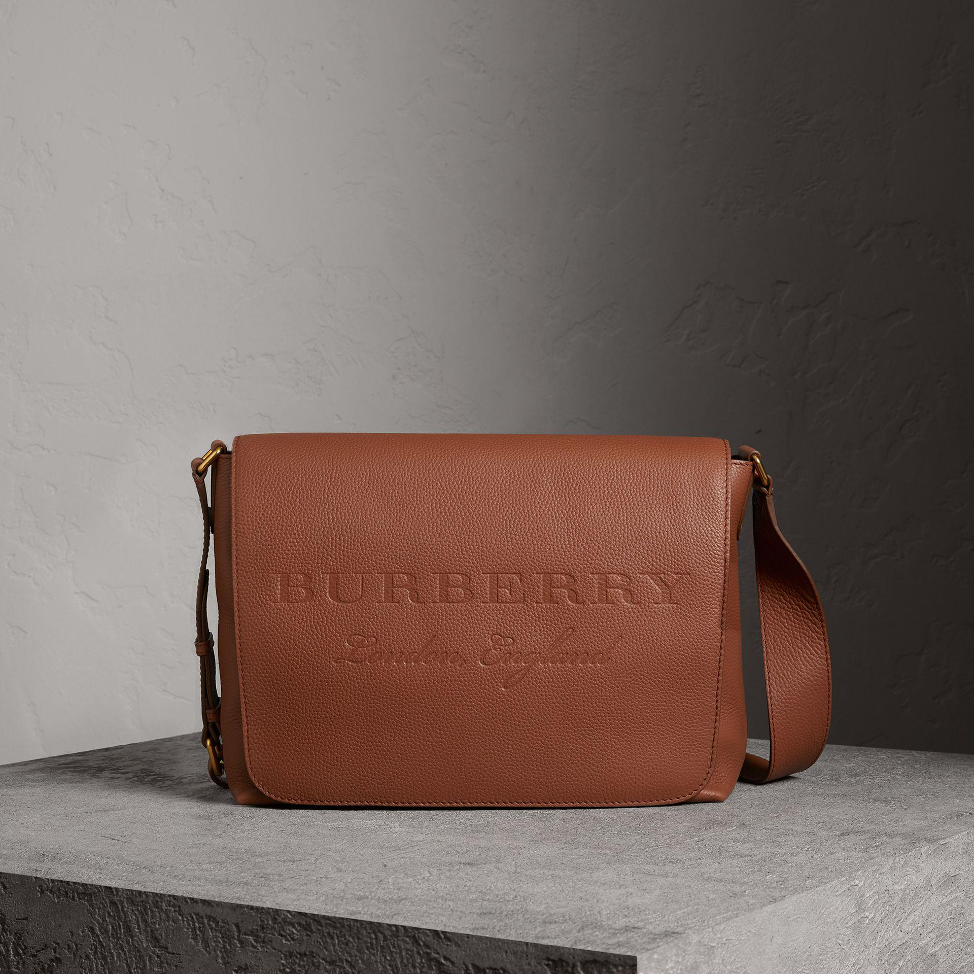 2d606bdd4f10 Lyst - Burberry Large Embossed Leather Messenger Bag in Brown