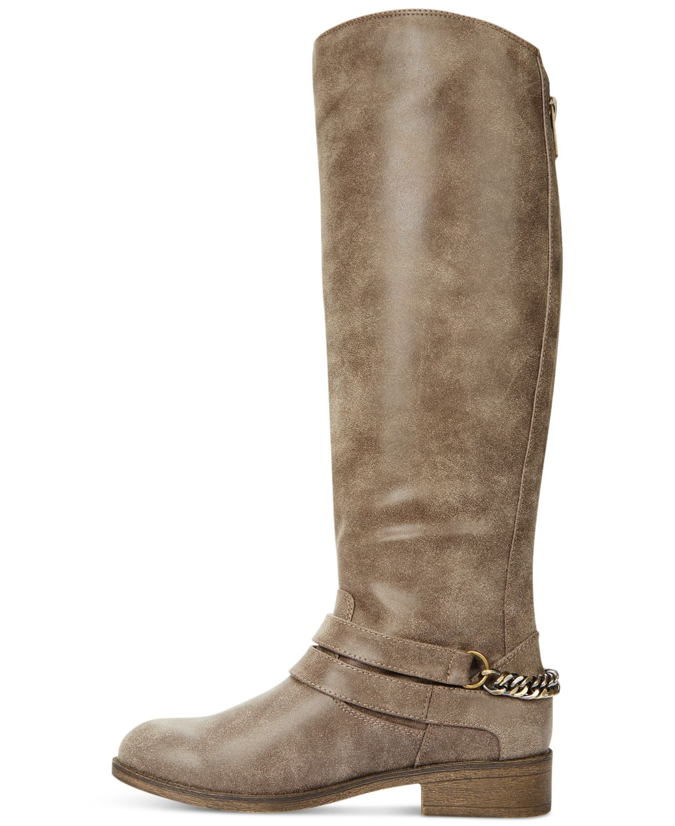 BareTraps® Oria tall boots offer a man made upper with an elastic back, zipper closure, and a three button detail finish. The insole is padded and it has a rubber outsole. The shaft height is , heel height is and it has a circumference.