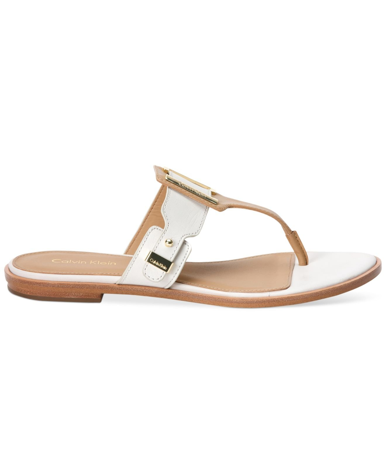f7748de3b35 Lyst - Calvin Klein Women S Ula Buckle Thong Sandals in Metallic