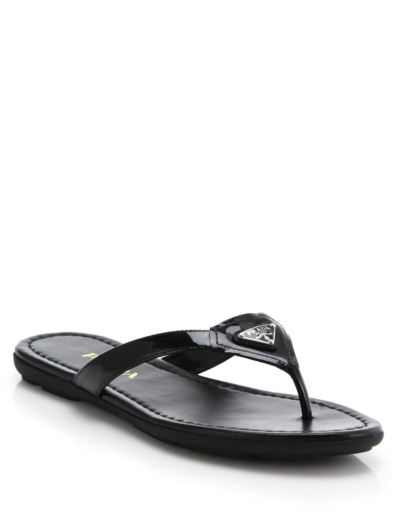 5af1cac0c7fd5f Lyst - Prada Logo Patent Leather Thong Sandals in Black