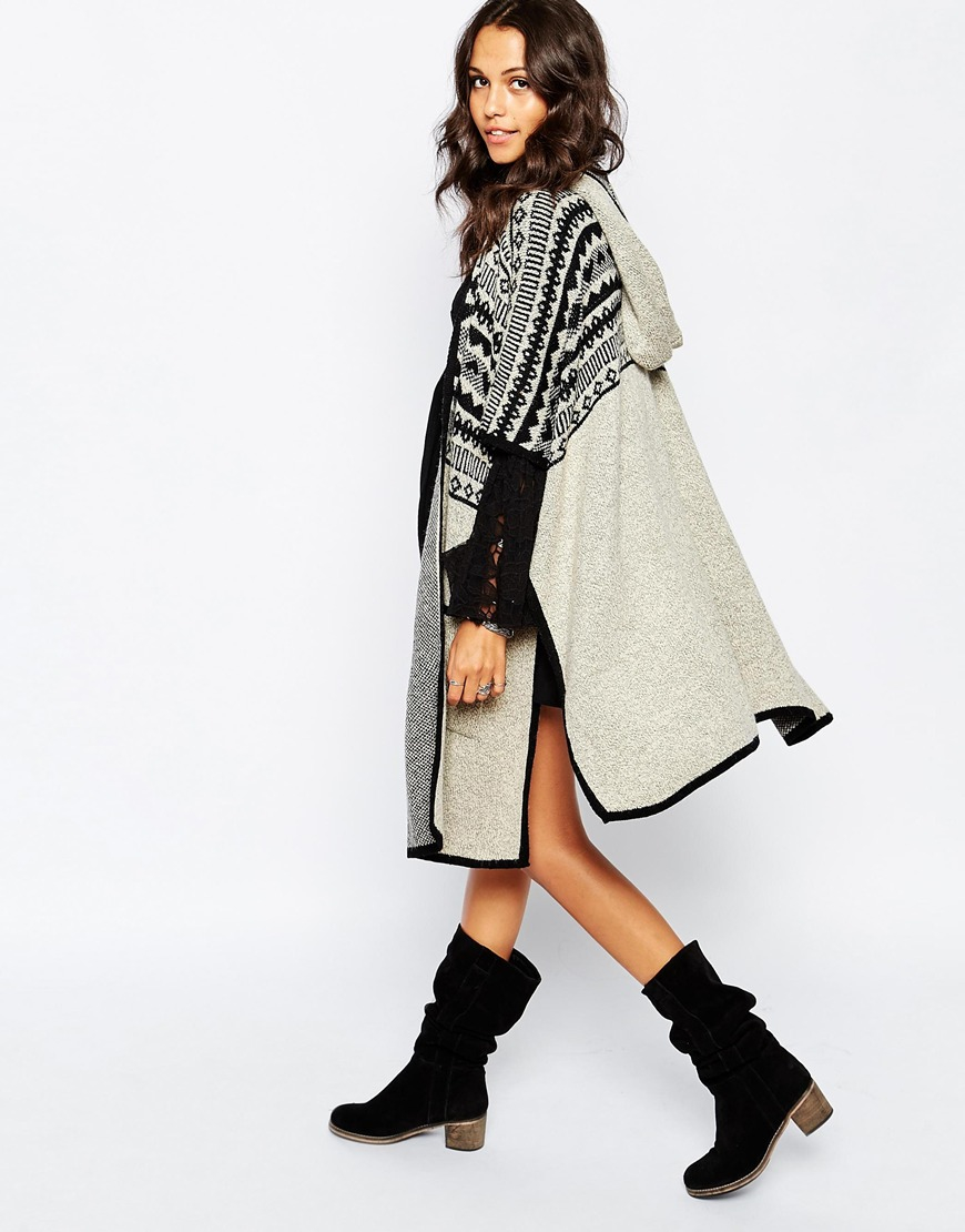 Lyst - Stitch & Pieces Pattern Knit Hooded Poncho With Pockets in ...