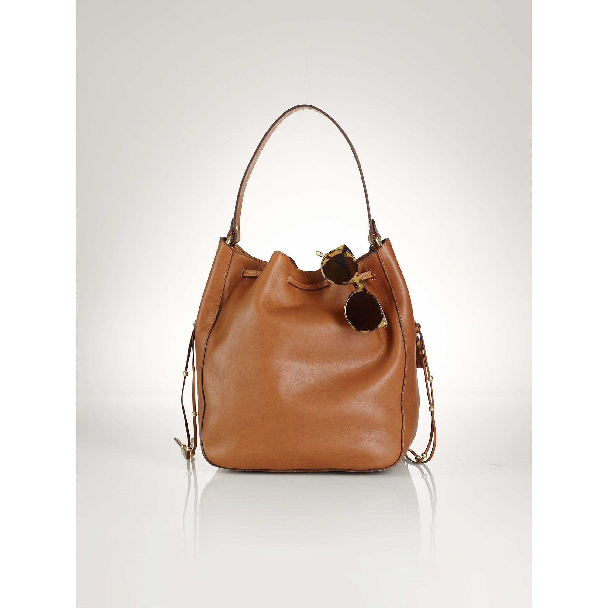 86458bfd92 ... uk lyst polo ralph lauren laced leather drawstring bag in brown 95d46  ee390