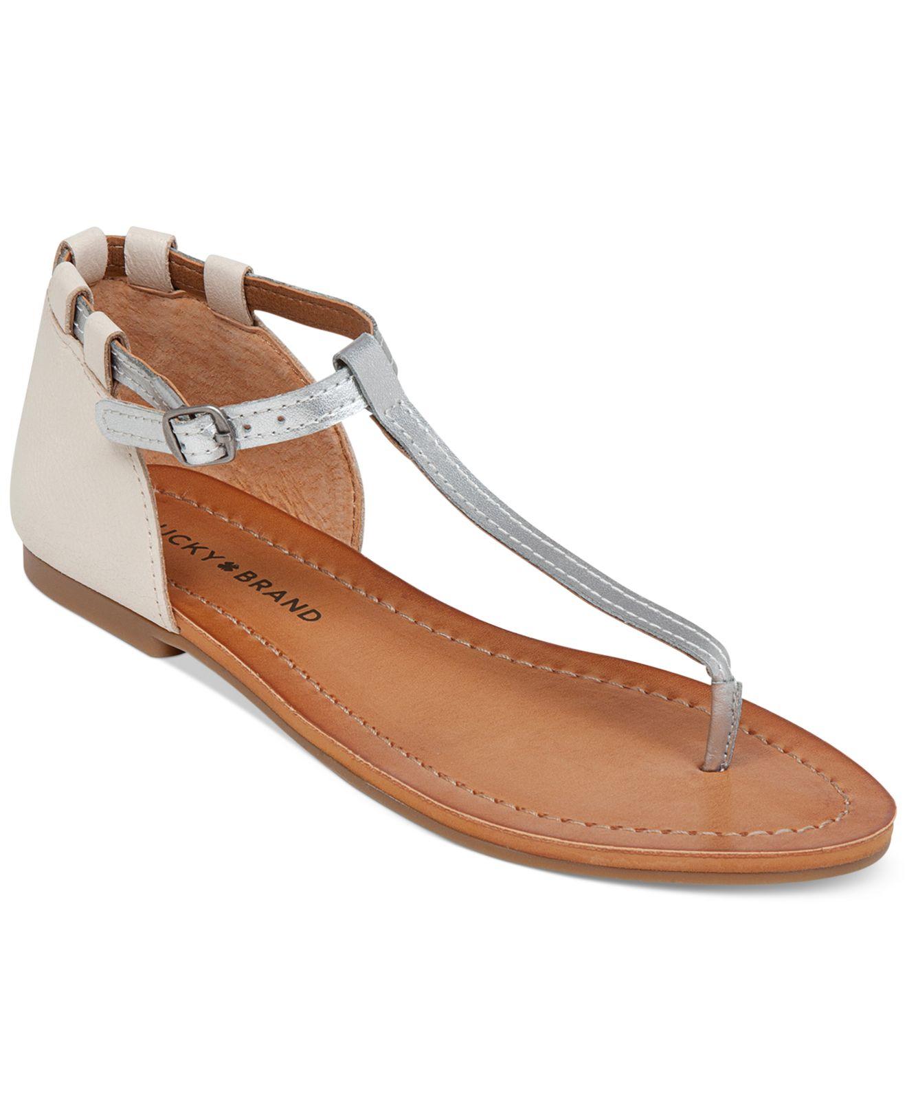 Flat sandals with metallic straps
