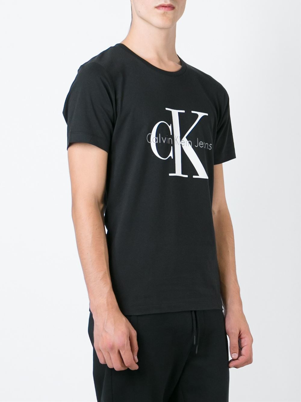 lyst calvin klein jeans logo print t shirt in black for men. Black Bedroom Furniture Sets. Home Design Ideas