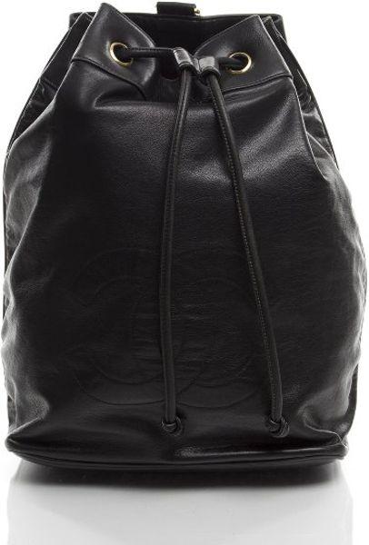 edf62ff71f37 Chanel Preowned Black Lambskin Cc Drawstring Crossbody Bag in Black | Lyst