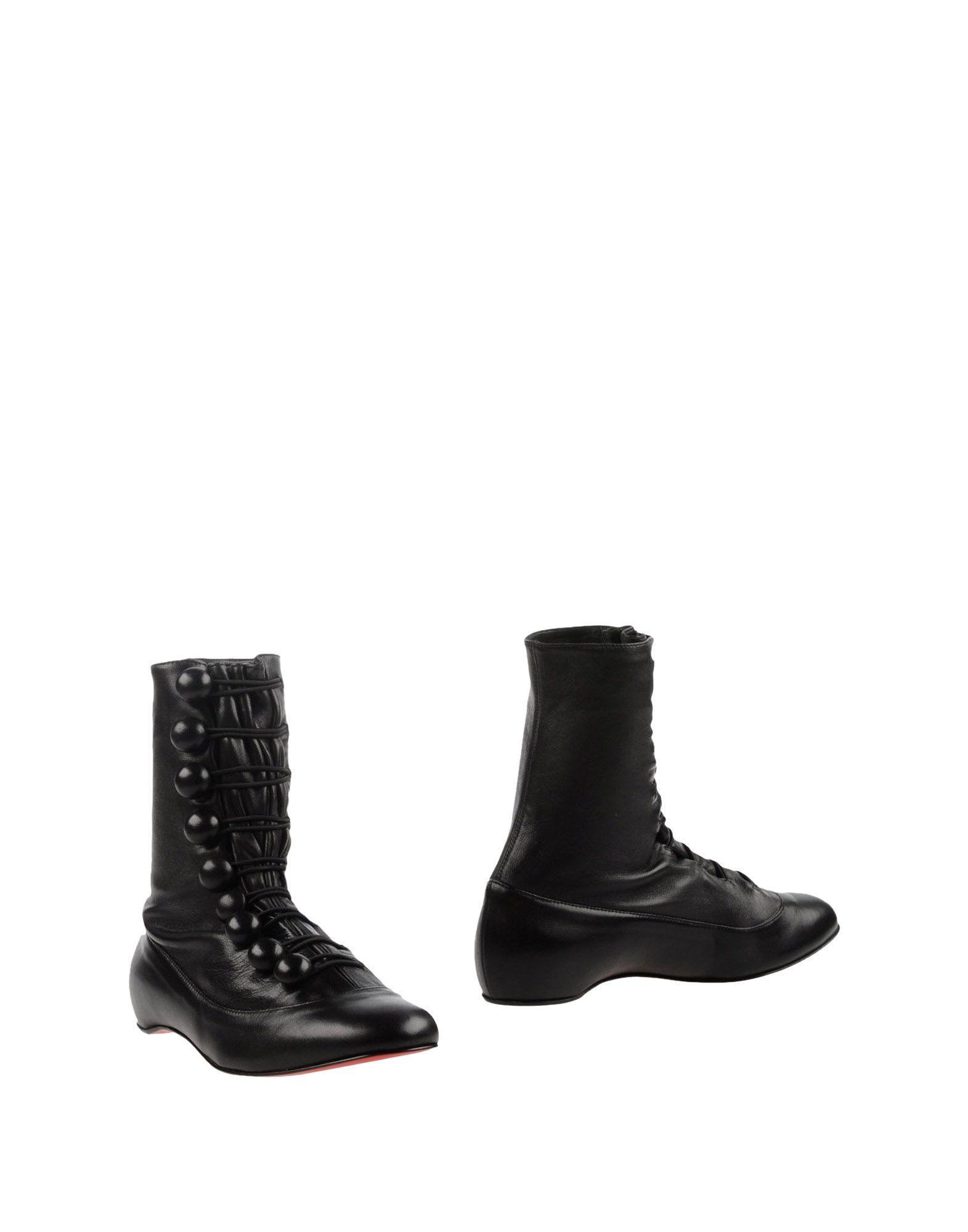 christian louboutin mid-calf wedge boots