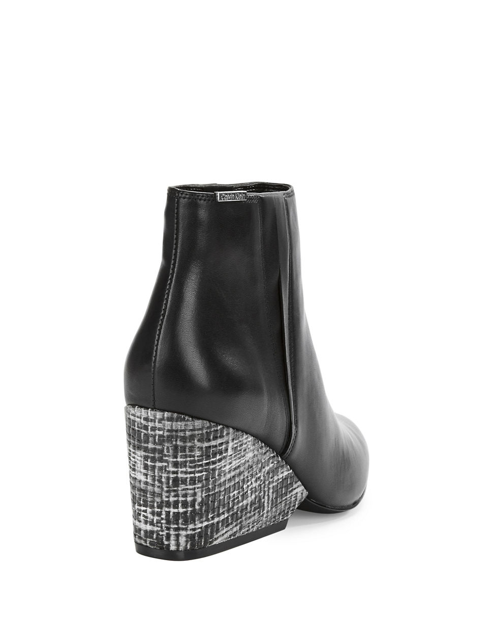 7332d3268fc Calvin Klein Celine Leather Ankle Boots in Black - Lyst