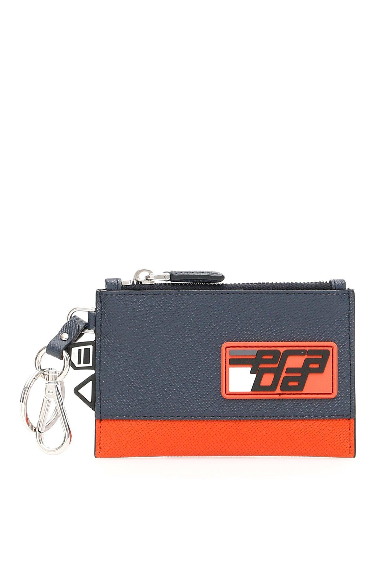 b53f2f1c9daf0c Prada Rubber Logo Patch Zipped Wallet in Blue for Men - Lyst