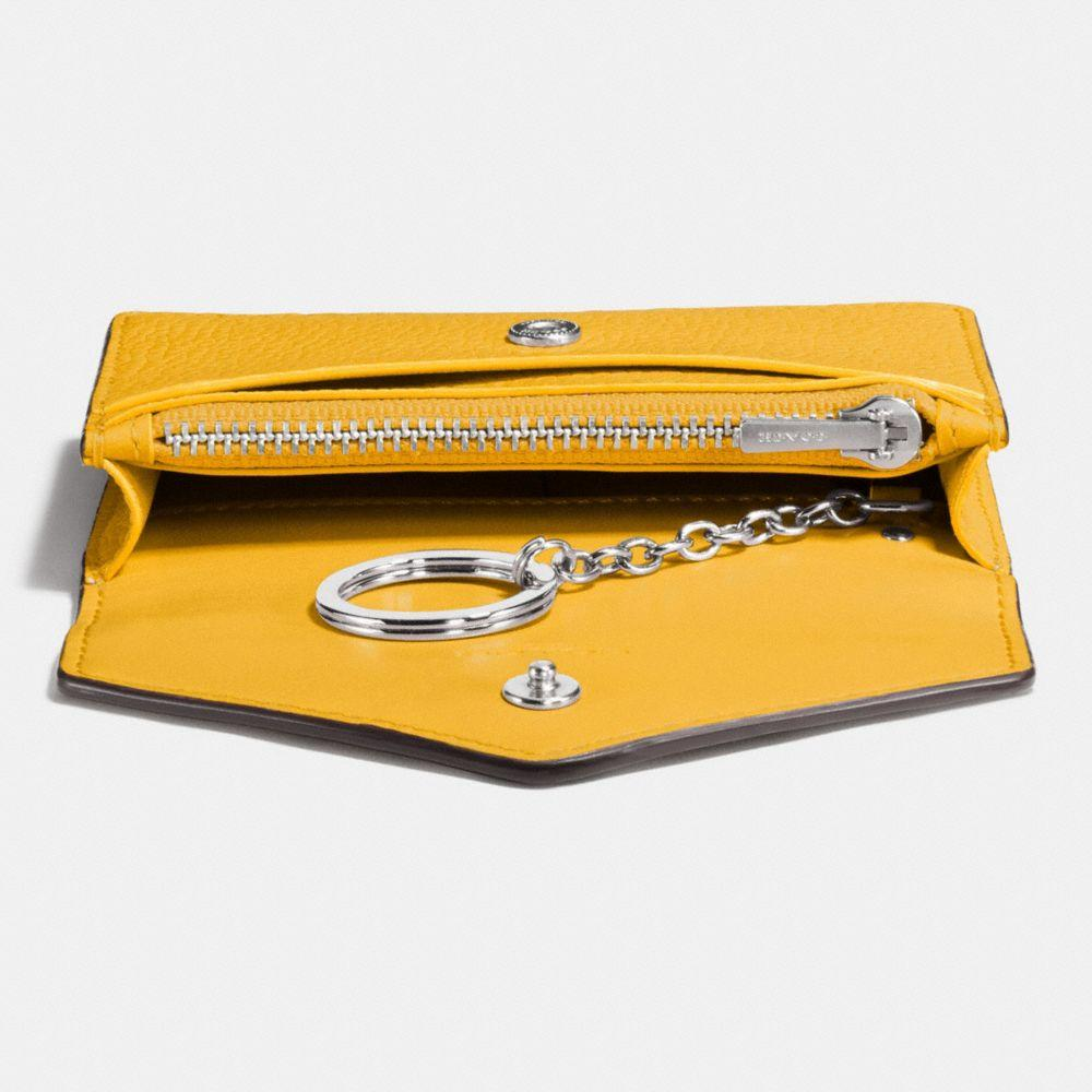 a33ac2b31d05 Lyst - COACH Envelope Card Case In Polished Pebble Leather in Yellow