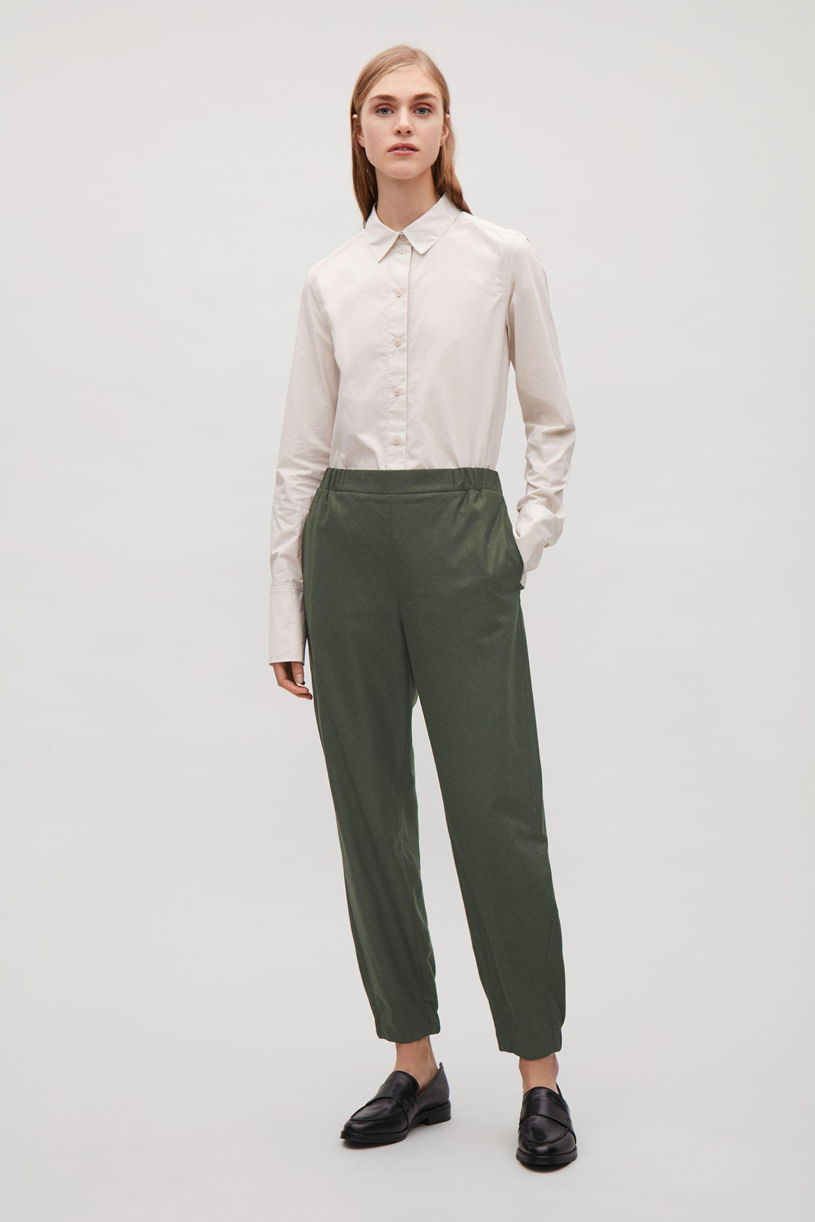 17d2bc565584e COS Wool Trousers With Elastic Detail in Green - Lyst