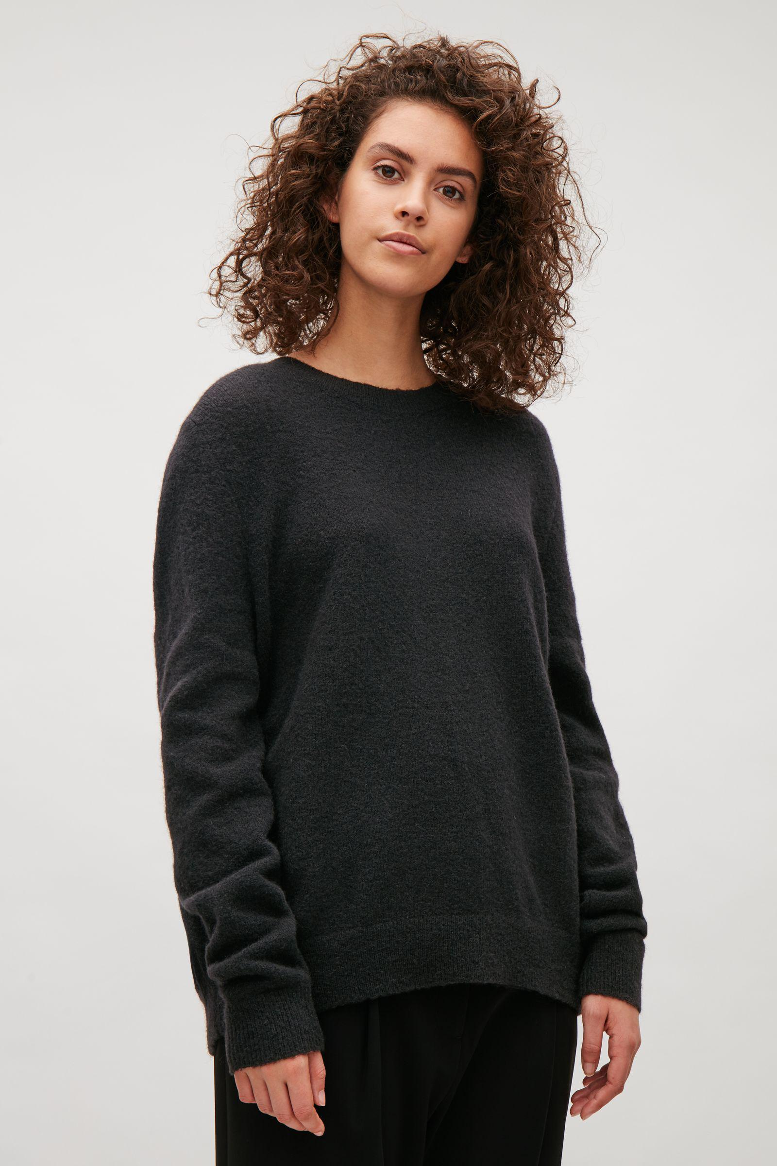 1e51ef0d4f57 COS Bow Back Jumper in Black - Lyst