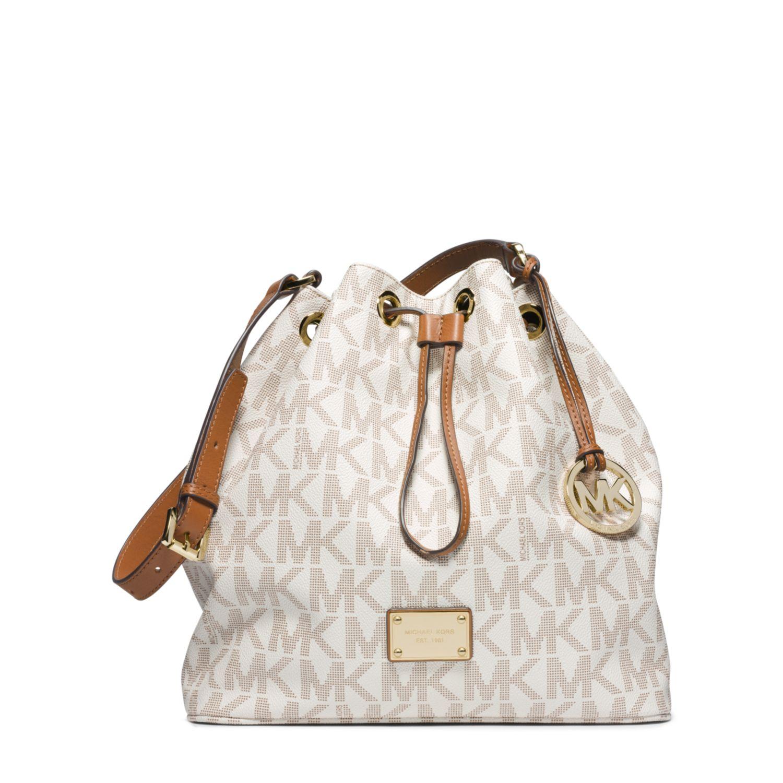 c12f883c821eac Michael Kors Jules Drawstring Logo Large Shoulder Bag in White - Lyst