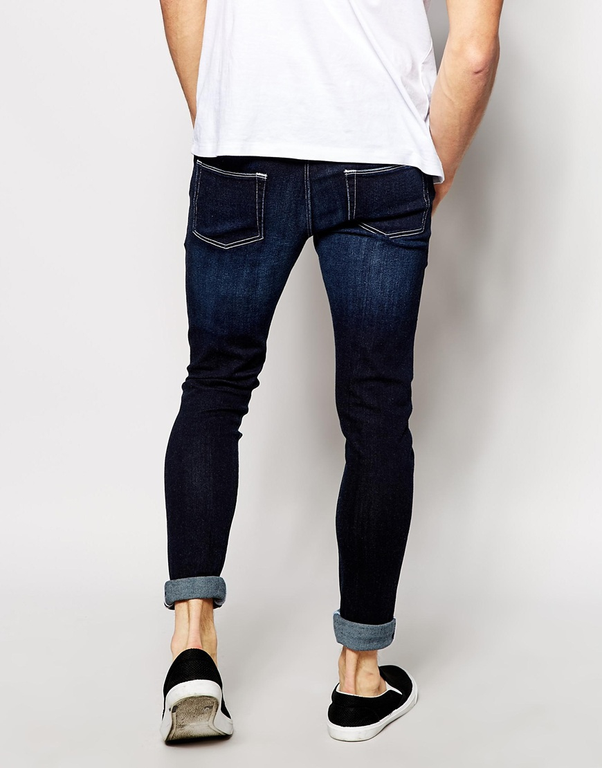 asos extreme super skinny jeans in dark wash in blue for. Black Bedroom Furniture Sets. Home Design Ideas