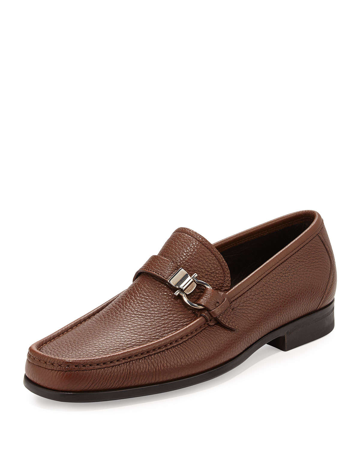 SALVATORE FERRAGAMO MEN'S SHOES, SNEAKERS, LOAFERS, AND SLIP ON SHOES. Step out in style with Salvatore Ferragamo men's shoes. Ranging from classic loafers handcrafted from the finest Italian leather to cool and casual sneakers for weekend activities, our collection of shoes from Salvatore Ferragamo caters to your keen sense of fashion.