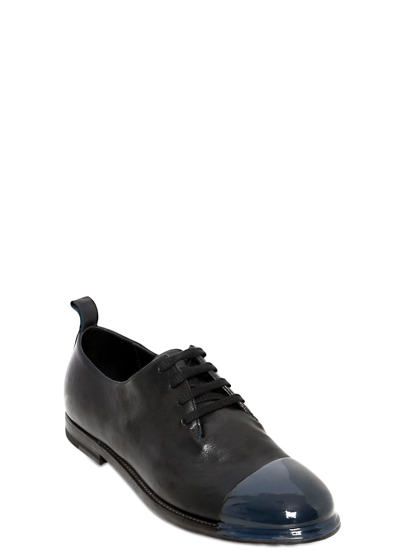 bottega veneta resin coated washed leather derby shoes in