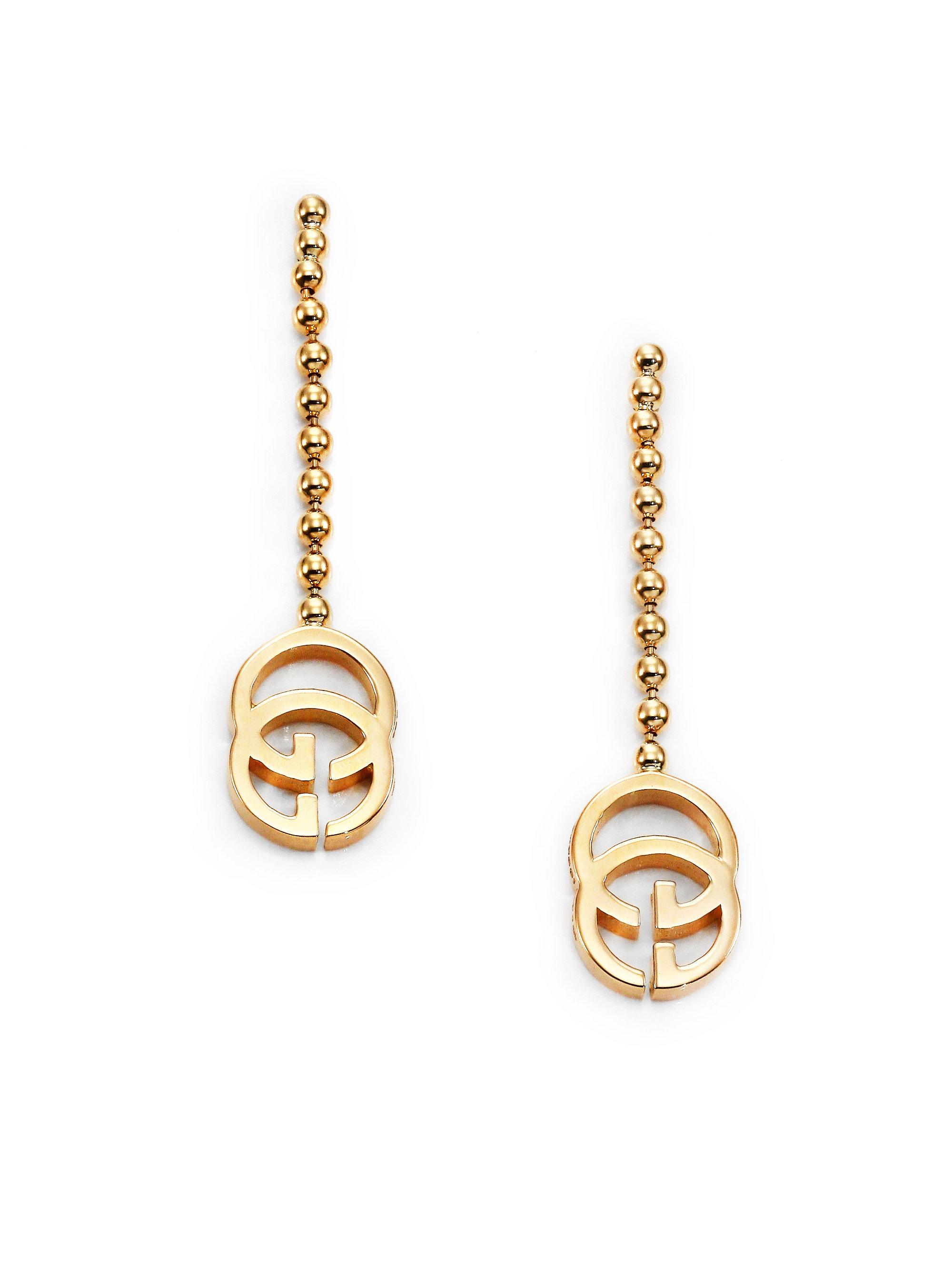 514dc484771 Lyst - Gucci Running G 18k Yellow Gold Drop Earrings in Metallic