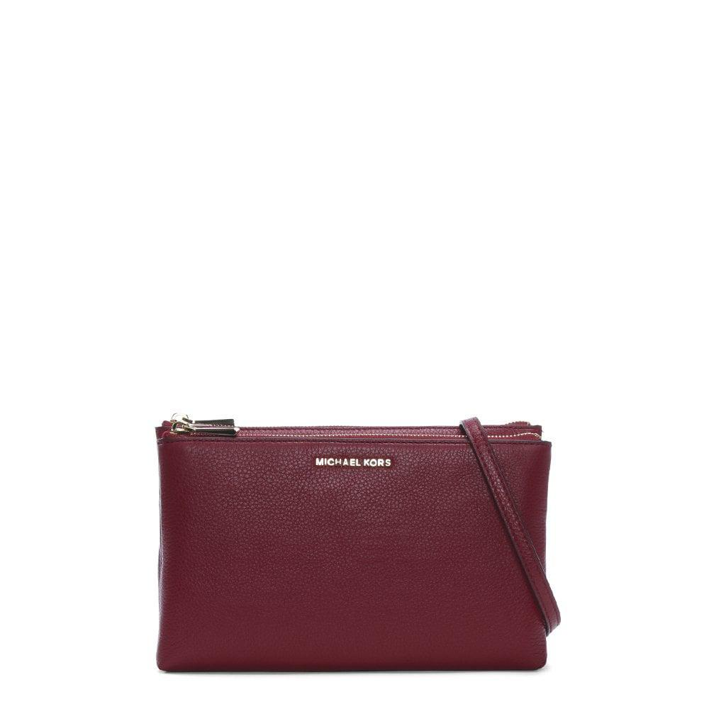 448424da24 ... Gusset Maroon Pebbled Leather Cross-body Bag - Lyst. View fullscreen