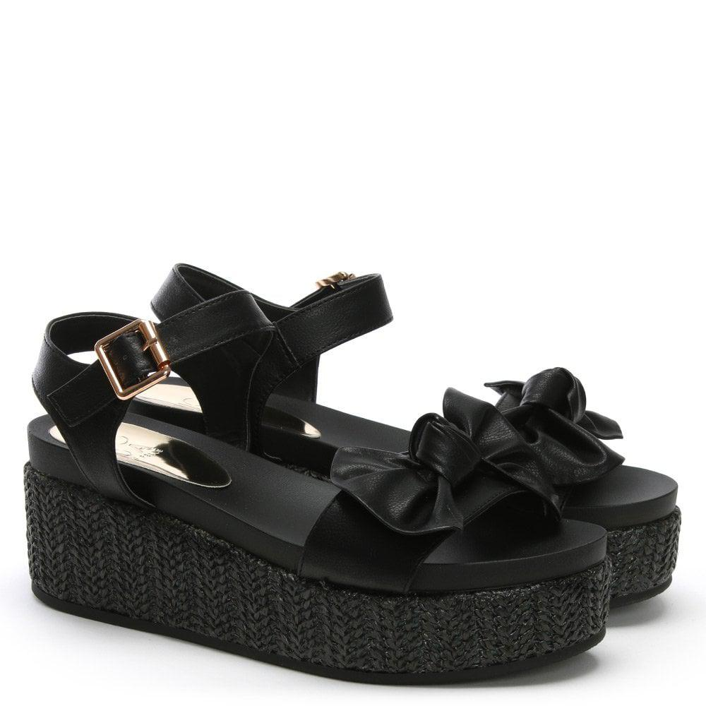 17ac2b24379e Moda In Pelle Pasha Black Bow Flatform Sandals in Black - Lyst