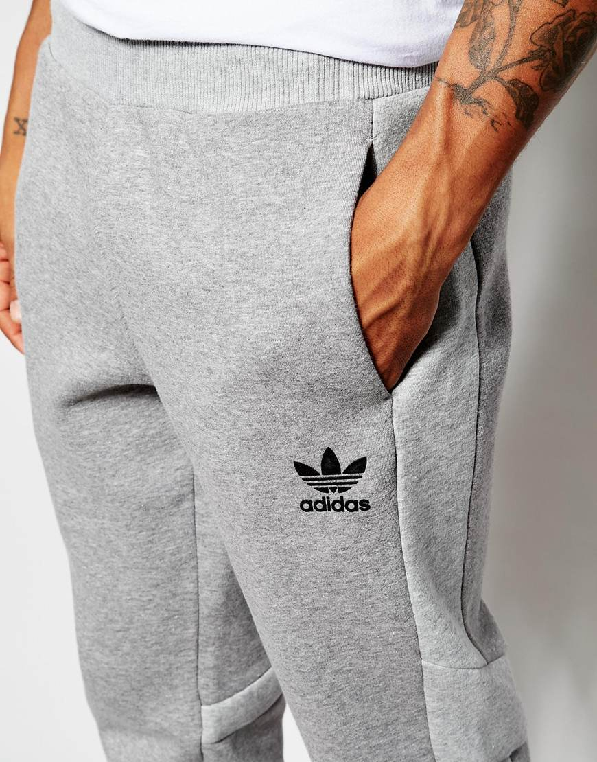 lyst adidas originals skinny trackpants with panels in