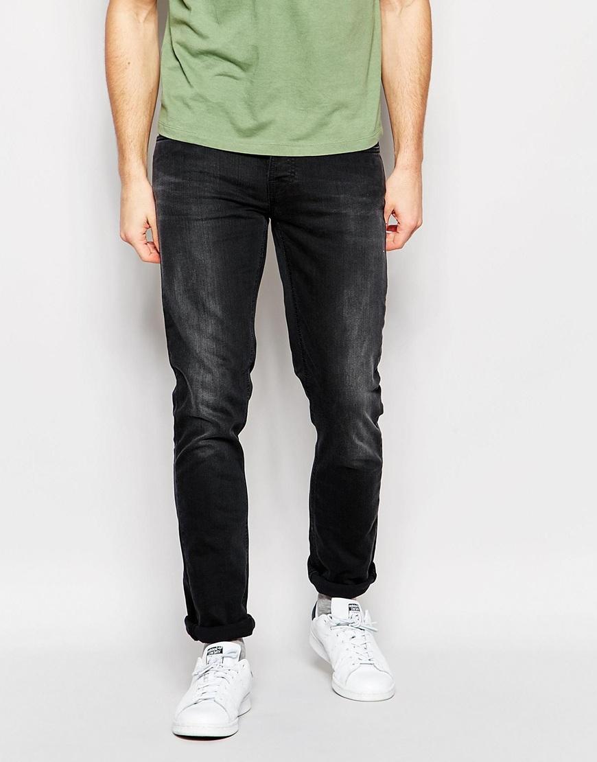 lyst nudie jeans grim tim slim fit black out in blue for men. Black Bedroom Furniture Sets. Home Design Ideas