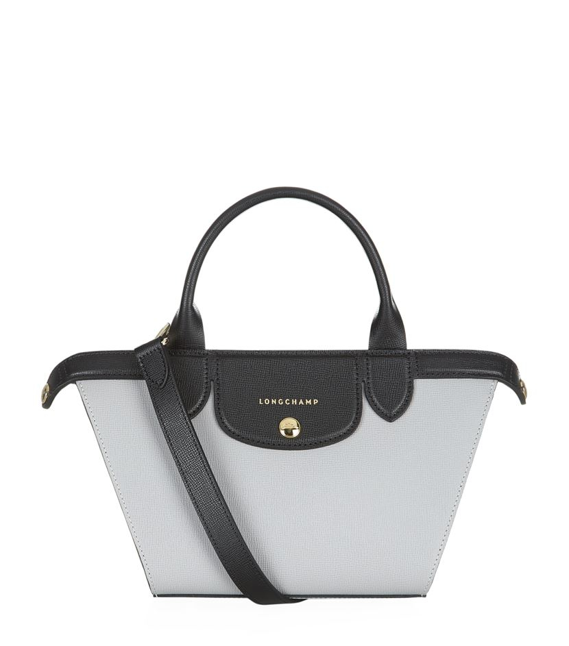 23fd0af409a Longchamp Le Pliage Heritage Small Top Handle Bag in Black - Lyst