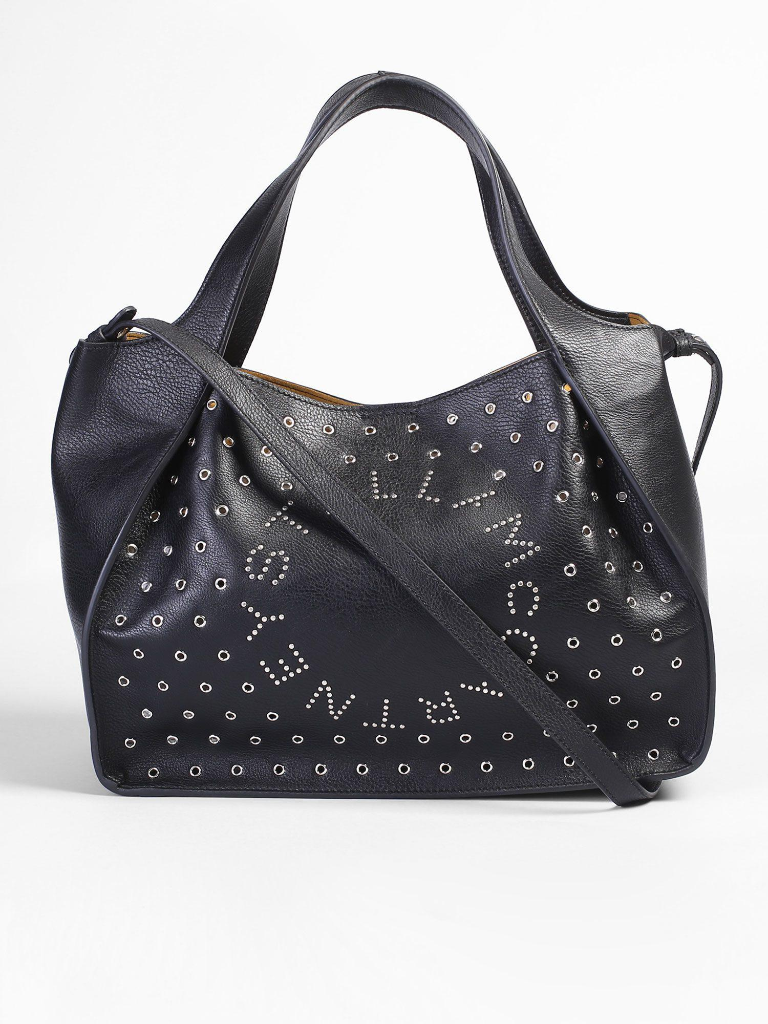 5f05a1073808 Lyst - Stella Mccartney Studded Faux Leather Tote Bag in Black