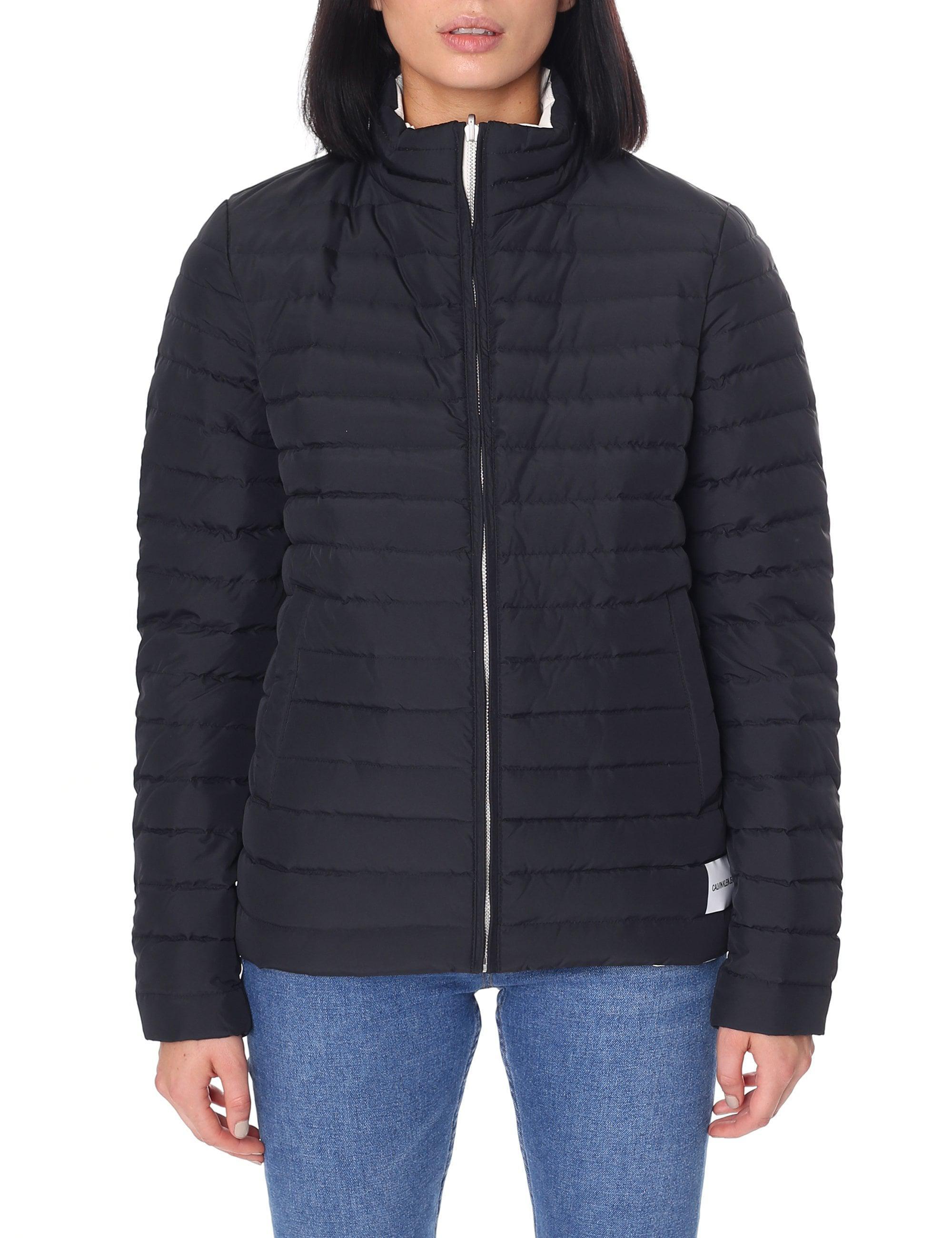 27d3ed02941 Calvin Klein Women s Reversible Puffer Jacket Ck Black egret in ...