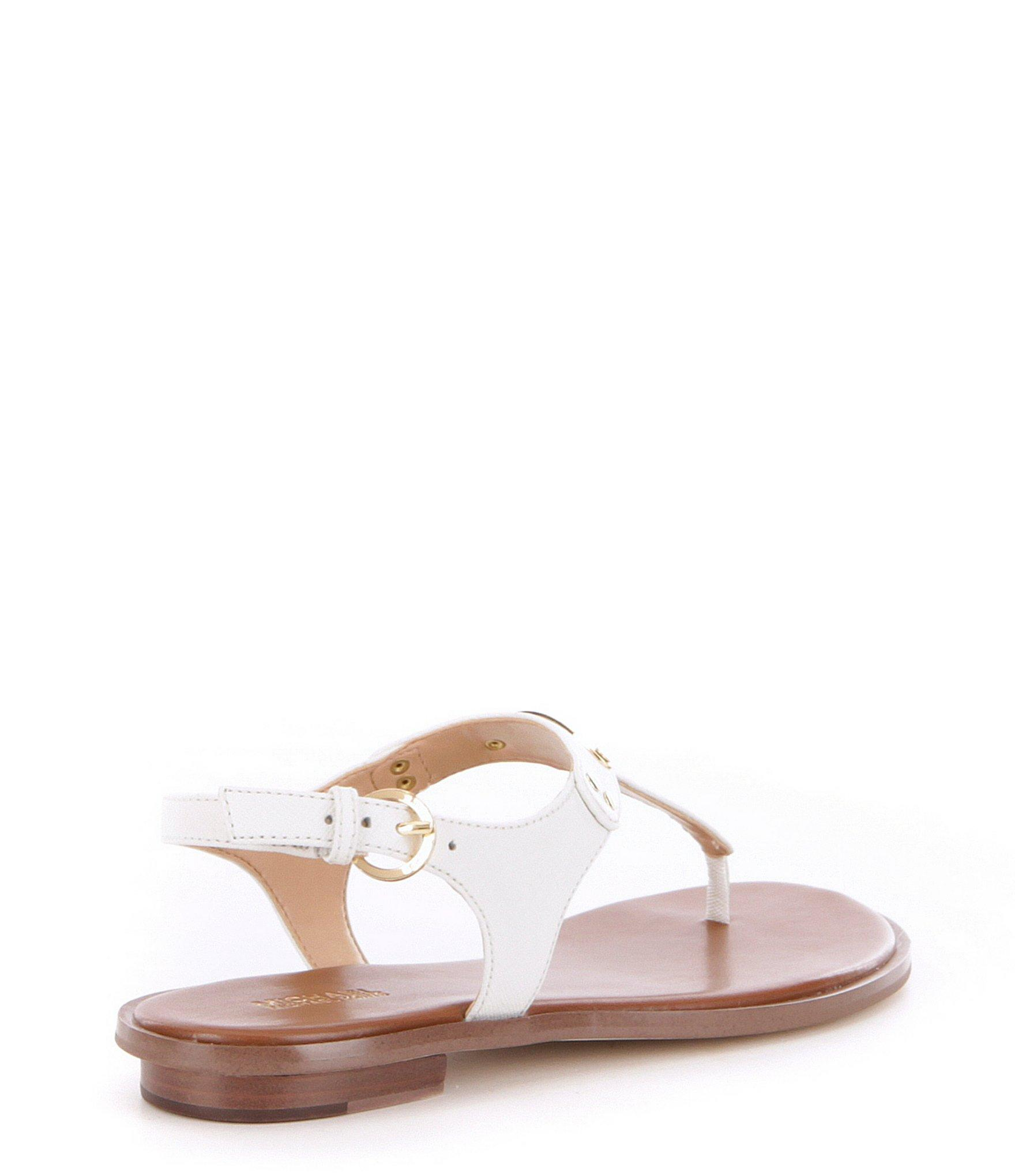 f63cac5f7 MICHAEL Michael Kors - White Mk Plate Saffiano Leather Thong Sandals -  Lyst. View fullscreen
