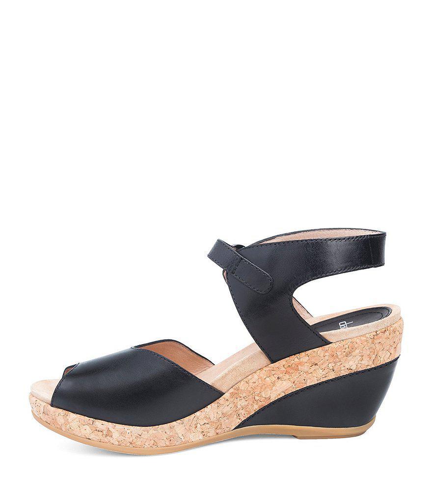 2b04127a9b9 Lyst - Dansko Charlotte Wedge Sandals in Black