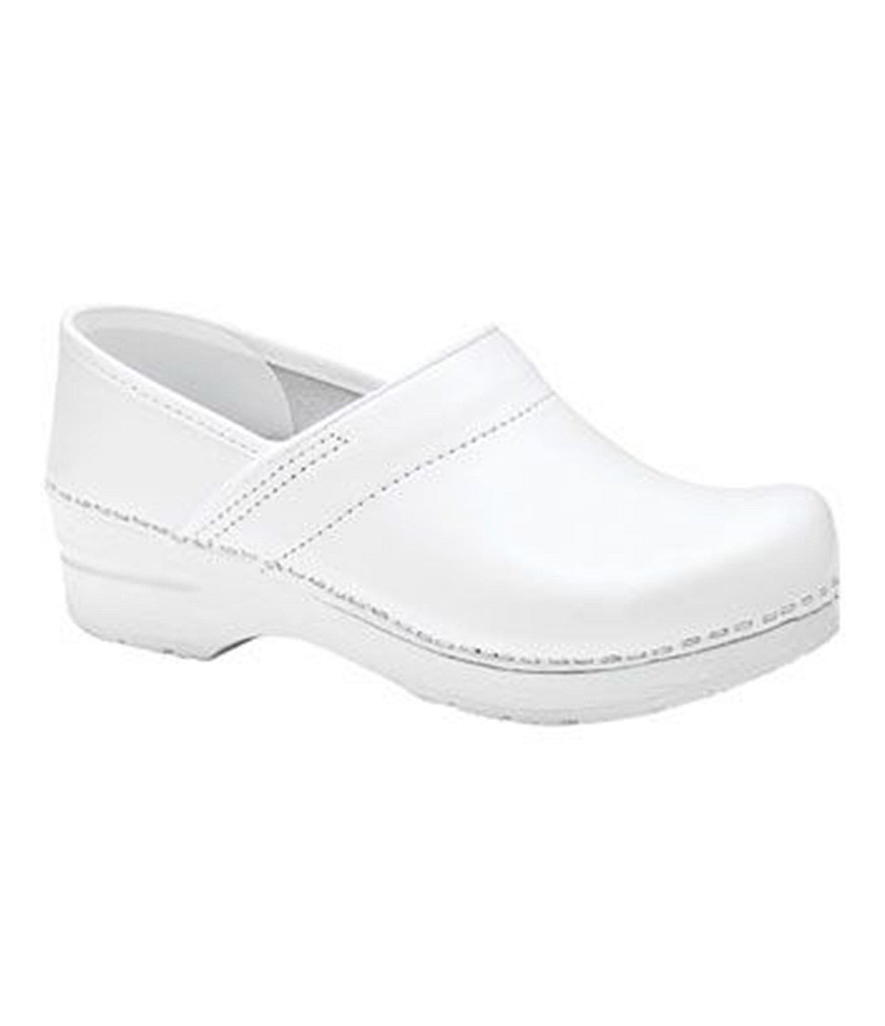 dansko professional clogs in white lyst