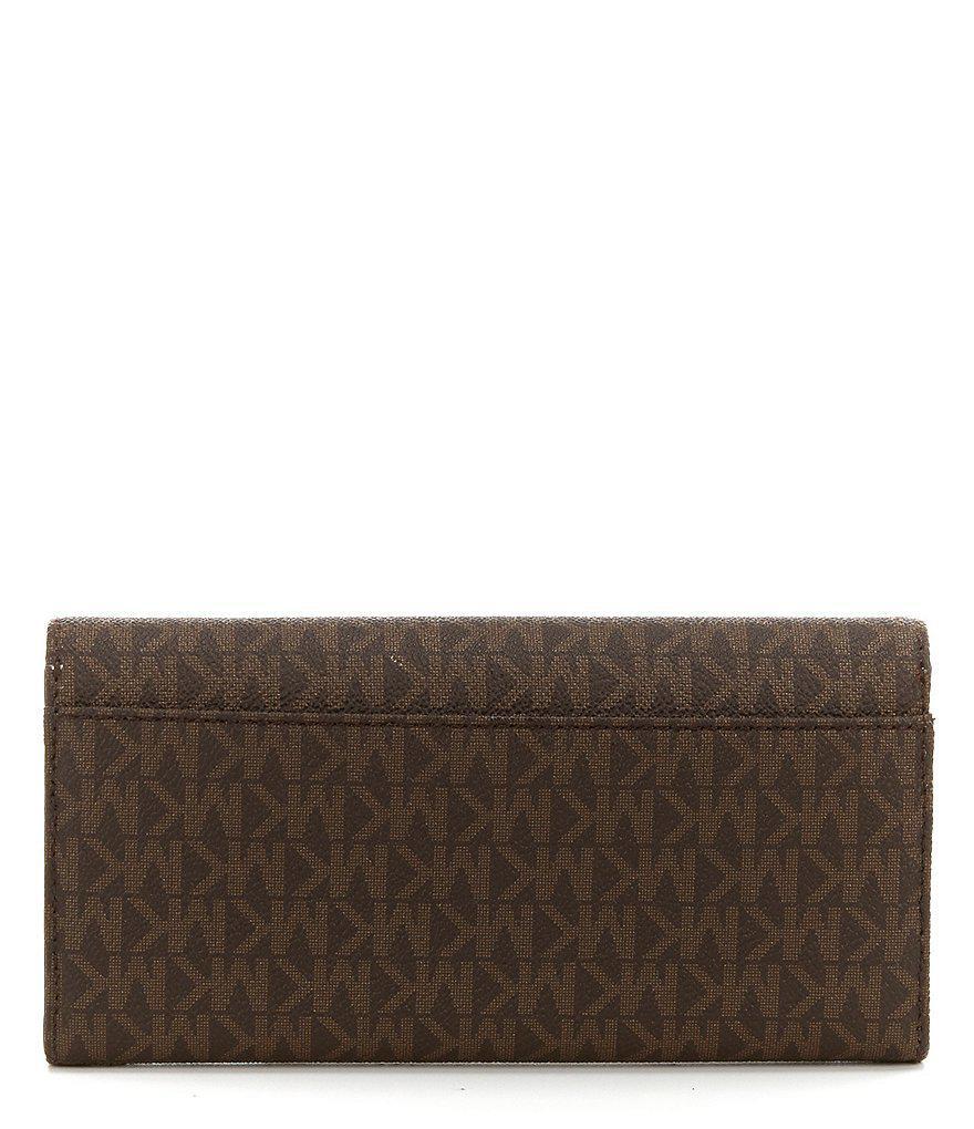 a5914920e7db ... promo code for michael michael kors brown fulton signature carryall wallet  lyst. view fullscreen 3708d